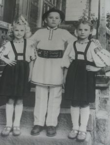 Oana's mum with her siblings, wearing folk blouses made by their mother.